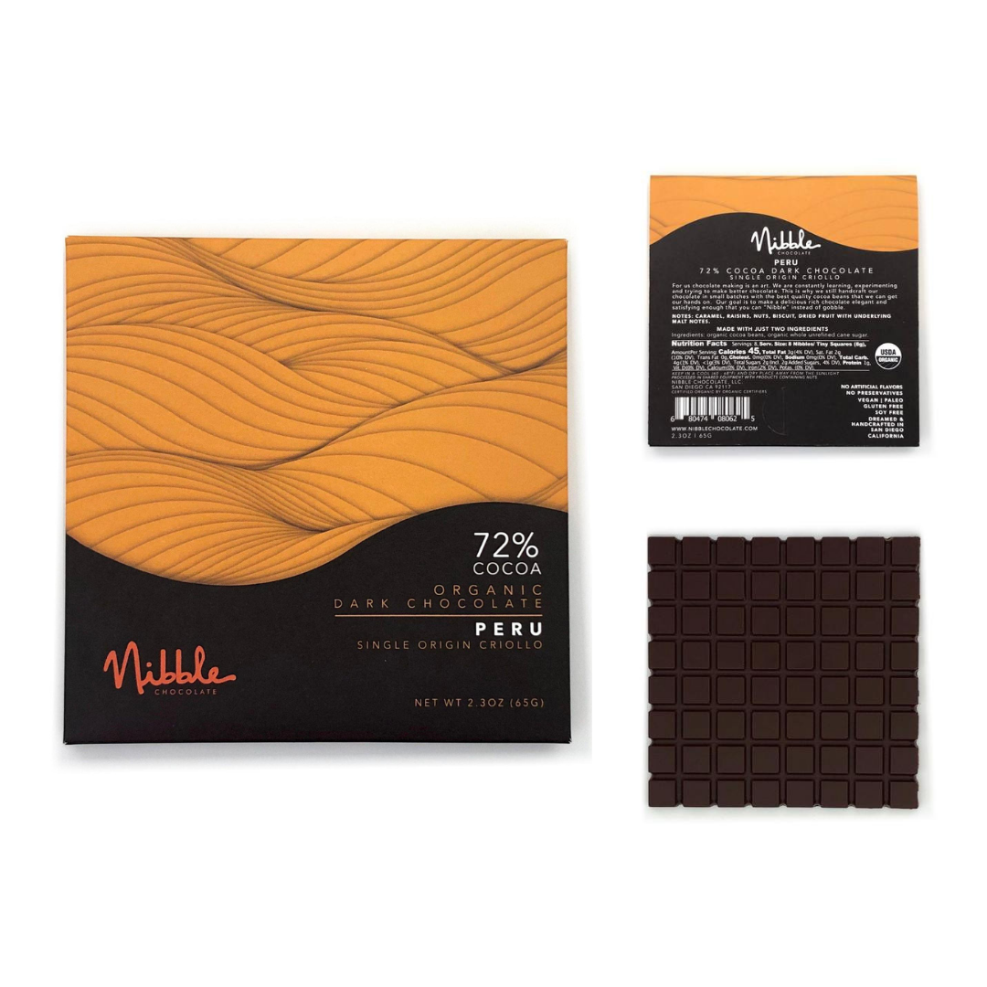 A square chocolate bar and the package for the bar from Nibble Chocolate. A yellow and brown wavelike graphic design.